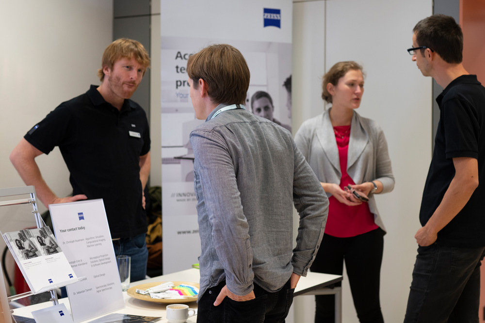 Students at the company stands at the career fair at Photonics Days 2019.